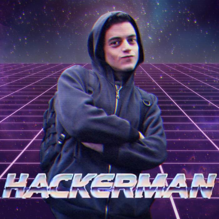 Meme de Rami Malek dans la série Mister Robot. Celui-ci porte un gilet bleu marine, il a mis sa capuche et porte un sac à dos sur le dos. Il croise les bras et à un petit sourire avec la bouche fermée. Il est écrit Hackerman. Derrière, nous pouvons voir la voie lactée avec des quadrillages néons violets. Tout le meme est d'ailleurs dans les tons violet.